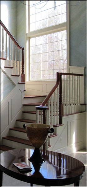 white staircase with wood railing