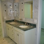 granite bathroom with double sinks