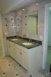 granite bathroom with double sinks